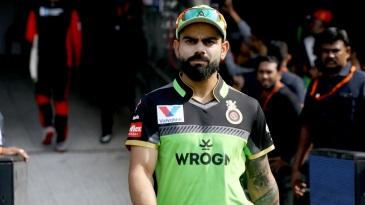 Virat Kohli walks out for the toss