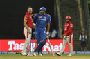 Hardus Viljoen and Kieron Pollard tower over Sarfaraz Khan, Mumbai Indians v Kings XI Punjab, IPL 2019, Mumbai, April 10, 2019