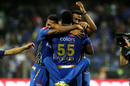 The Pandyas pile onto Kieron Pollard after Mumbai seal a last-ball win, Mumbai Indians v Kings XI Punjab, IPL 2019, Mumbai, April 10, 2019