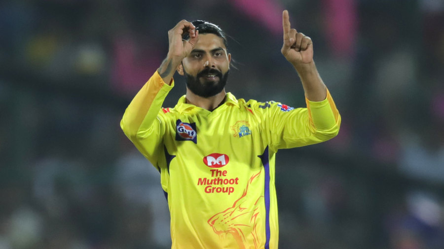 Ravindra Jadeja signals to the dugout after taking this 100th wicket in the IPL