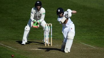 Tom Lace of Derbyshire presses forward to drive