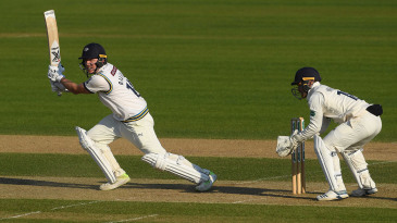 Gary Ballance of Yorkshire hits out as wicketkeeper Lewis McManus of Hampshire looks on