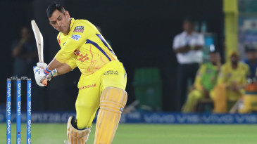 MS Dhoni watches the ball closely before launching it into the leg side