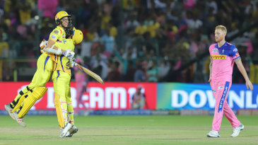 Ravindra Jadeja hugs Mitchell Santner after his last-ball six, while bowler Ben Stokes cuts a forlorn figure