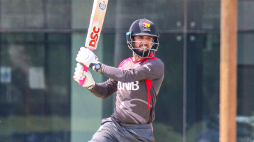 Rohan Mustafa drives over cover for a boundary
