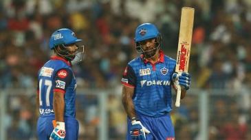 Shikhar Dhawan acknowledges the applause as Rishabh Pant looks on