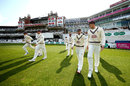Surrey's players walk onto The Oval, Surrey v Essex, County Championship, Division One, The Oval, April 13, 2019