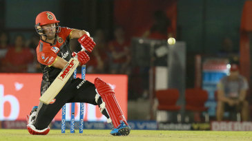 AB de Villiers watches closely as he shapes to scoop