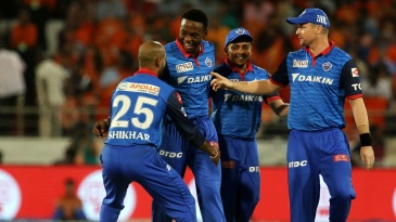 Kagiso Rabada is mobbed by his team-mates after taking two in two