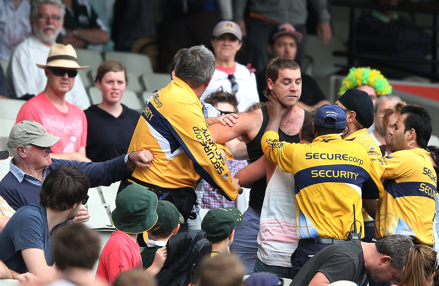Why should football fans have a monopoly on in-stadium argy bargy with security staff? A spectator is ejected during the 2012 MCG Test