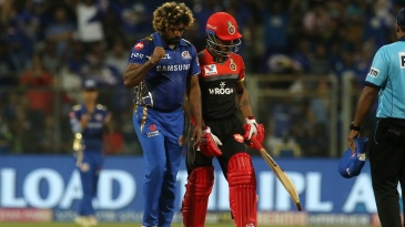 Lasith Malinga walks back to his mark after picking up a wicket