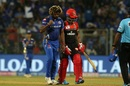 Lasith Malinga walks back to his mark after picking up a wicket, Mumbai Indians v Royal Challengers Bangalore, IPL 2019, Mumbai, April 15, 2019