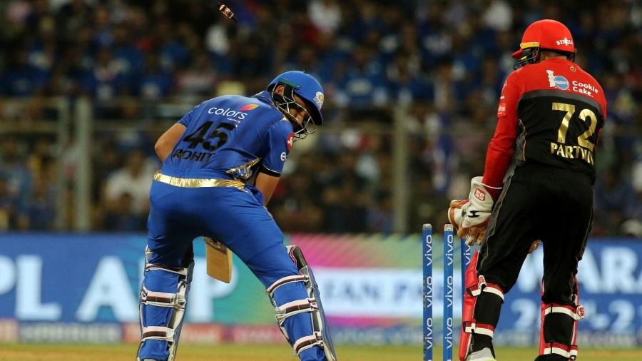 Rohit Sharma looks back after being cleaned up by one that turned sharply into him