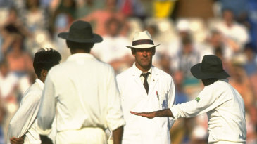 Pakistan's players arguing with umpire Roy Palmer after he warned Aaqib Javed for intimidatory bowling