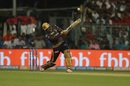 Andre Russell smashes one down the ground, Kolkata Knight Riders v Royal Challengers Bangalore, IPL 2019, Kolkata, April 19, 2019