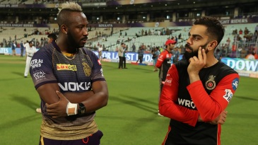 Andre Russell and Virat Kohli share a pensive moment