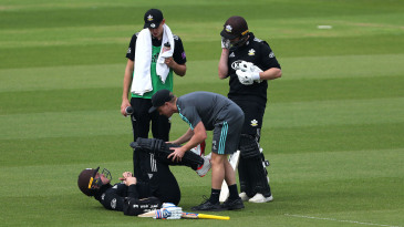 Jason Roy of Surrey receives treatment from the medical team
