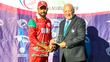 Bilal Khan accepts the Man of the Match award after his 4 for 30