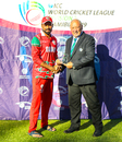 Bilal Khan accepts the Man of the Match award after his 4 for 30, Hong Kong v Oman, WCL Division Two, Windhoek, April 23, 2019