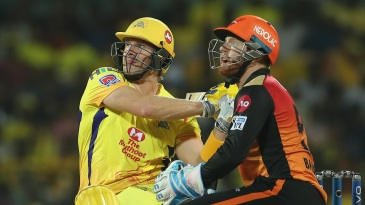 Shane Watson watches the ball sail away