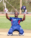 Xavier Marshall drops to his knees in celebration of his first official century for USA, Hong Kong v USA, WCL Division Two, Windhoek, April 24, 2019