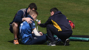Sam Billings receives treatment after hurting his shoulder - the injury that put him out of contention for the World Cup squad
