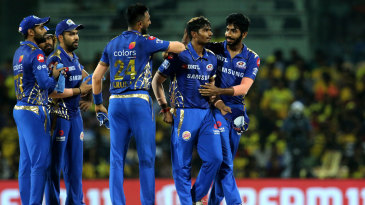 Anukul Roy is congratulated by his team-mates after getting his maiden IPL wicket