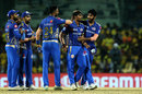 Anukul Roy is congratulated by his team-mates after getting his maiden IPL wicket, Chennai Super Kings v Mumbai Indians, IPL 2019, Chennai, April 26, 2019