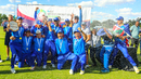 Namibia captain Gerhard Erasmus holds the WCL Division Two trophy aloft during champagne celebrations, Namibia v Oman, WCL Division Two, Final, Windhoek, April 27, 2019