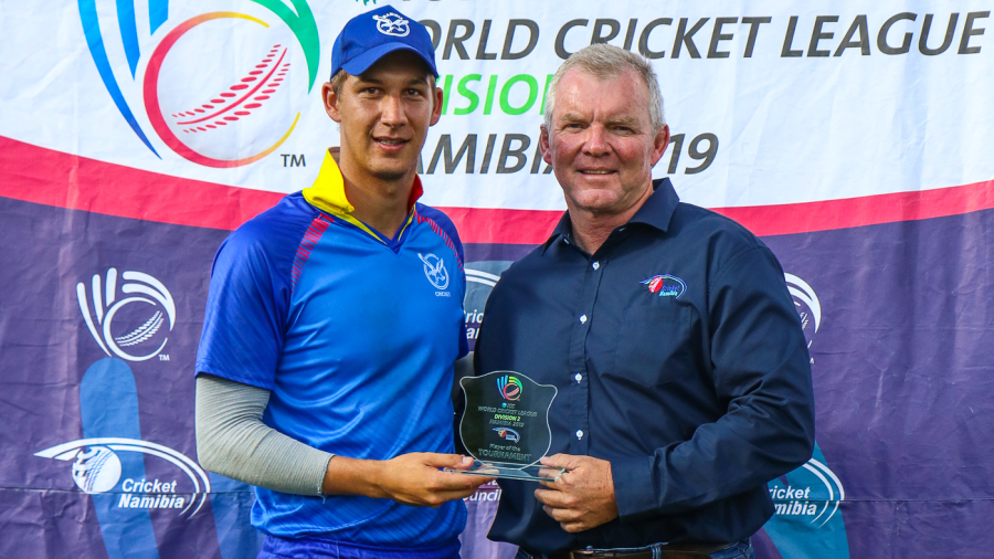 Namibia allrounder JJ Smit receives the Player of the Tournament award from former ICC board Associate representative Francois Erasmus