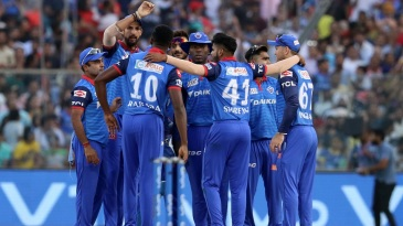 The Delhi Capitals players celebrate Parthiv Patel's dismissal