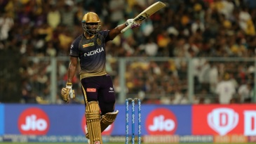 Andre Russell raises his fifty