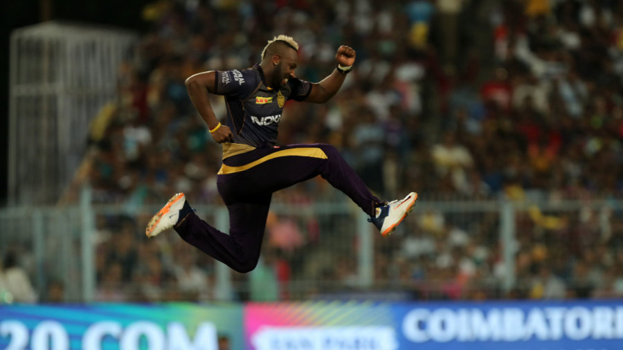 Andre Russell leaps in delight after taking a wicket