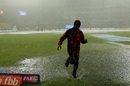A member of the groundstaff gets drenched in Bengaluru, Royal Challengers Bangalore v Rajasthan Royals, IPL 2019, Bengaluru, April 30, 2019