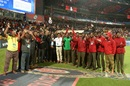 The groundstaff in Bengaluru pose for a photo while rain pounds the M Chinnaswamy Ground, Royal Challengers Bangalore v Rajasthan Royals, IPL 2019, Bengaluru, April 30, 2019