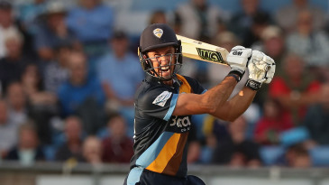 Wayne Madsen of Derbyshire drives the ball to the boundary