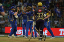 Robin Uthappa looks on as Lasith Malinga celebrates with his team-mates, Mumbai Indians v Kolkata Knight Riders, IPL 2019, Mumbai
