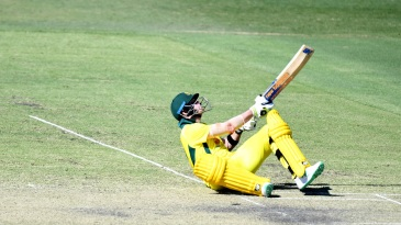 Steven Smith tumbles while playing a shot