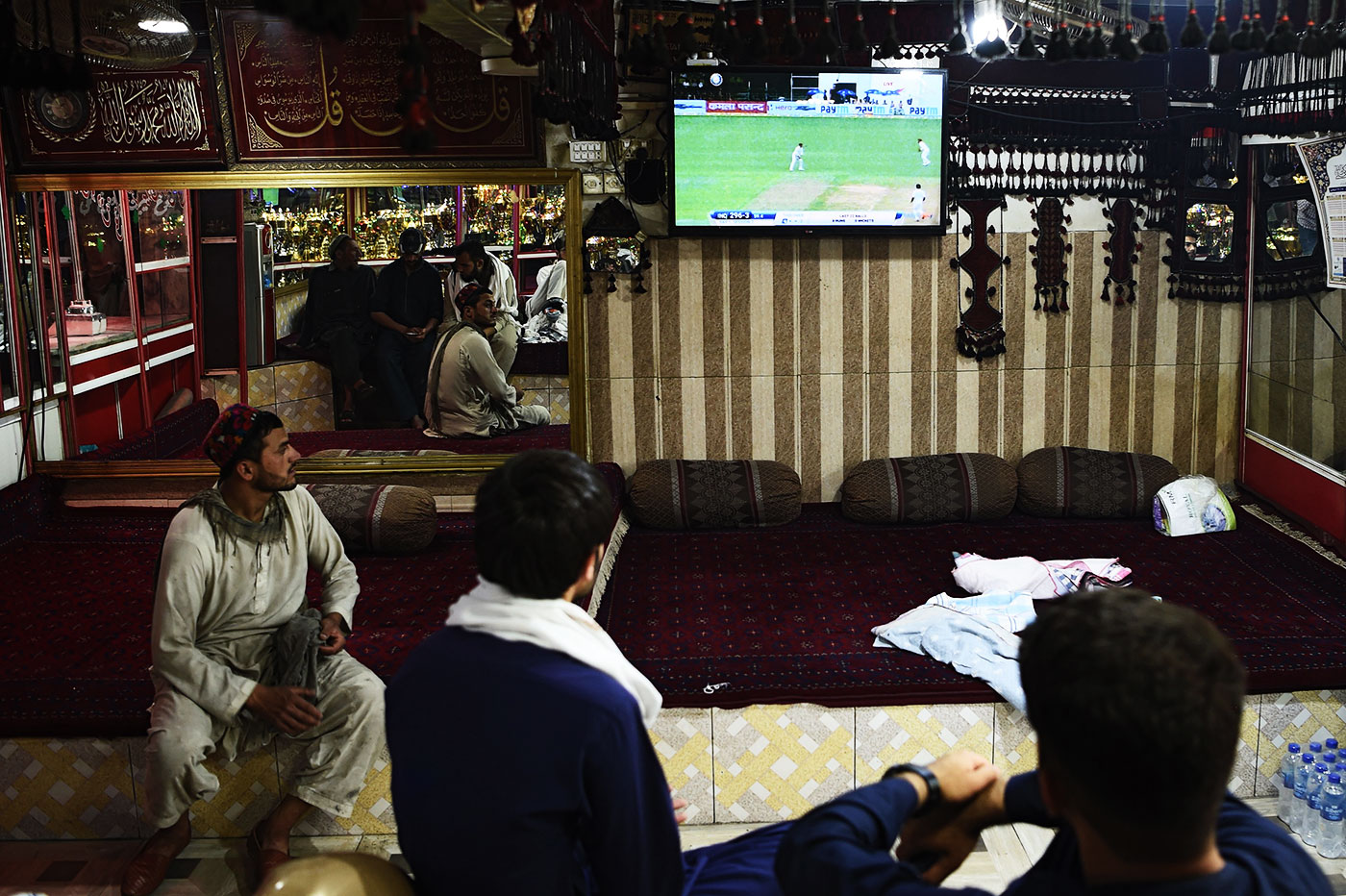 Customers in a restaurant in Kabul watch the India-Afghanistan Test in June 2018