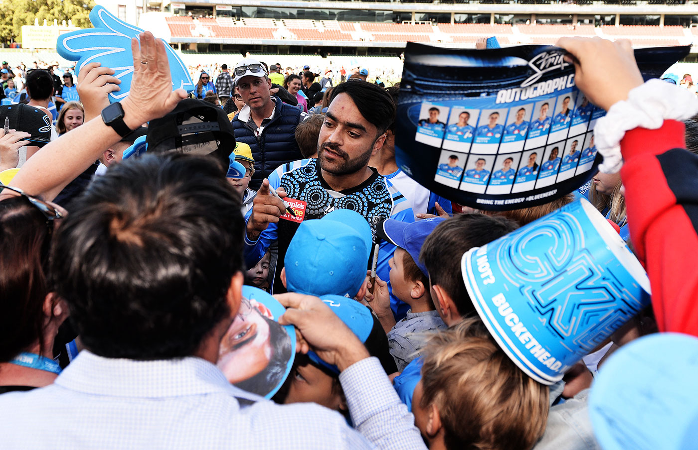 Fans clamour for Rashid Khan's attention