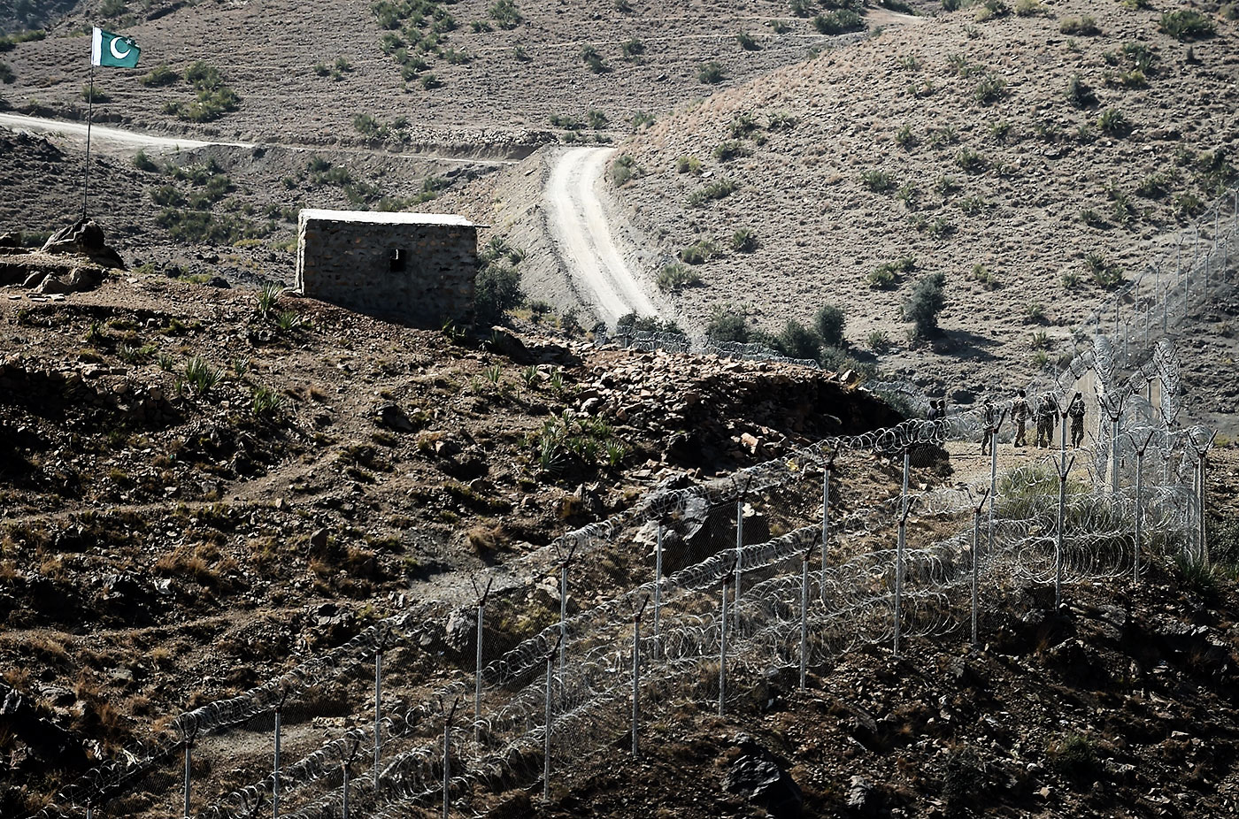 The same people on either side. Pakistani soldiers patrol the border with Afghanistan at Kitton Orchard Post in Pakistan's North Waziristan tribal agency