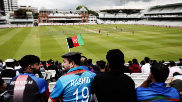 A supporter wears a Rashid Khan shirt