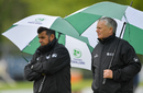 Umpires Aleem Dar and Mark Hawthorne take shelter from the rain, Ireland v Bangladesh, tri-series, Dublin, May 9, 2019