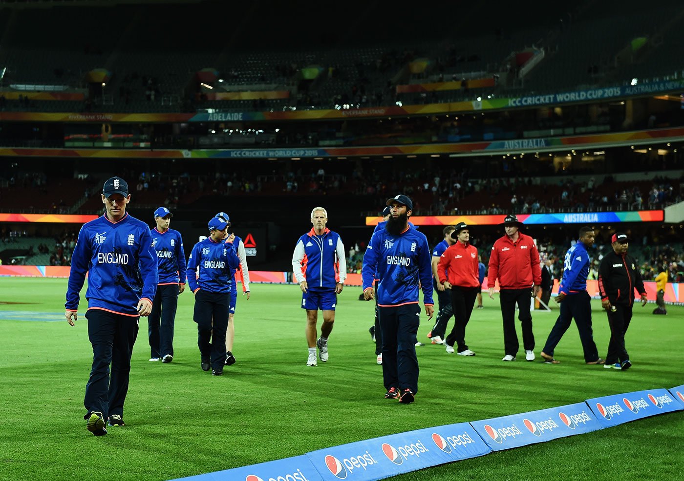 I get knocked down but I get up again: Morgan and his England team-mates walk off the field after their devastating exit from the 2015 World Cup