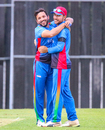 Afghanistan captain Gulbadin Naib celebrates with Rahmat Shah after taking a wicket, Scotland v Afghanistan, 2nd ODI, Edinburgh, May 10, 2019