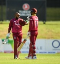 Sunil Ambris punches gloves with Roston Chase after his maiden ODI century, Ireland v West Indies, Match 4, Ireland tri-series, Dublin, May 11, 2019