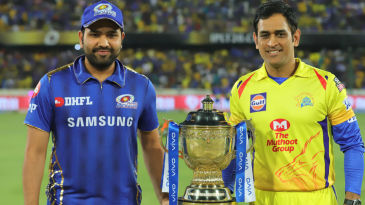 Rohit Sharma and MS Dhoni pose with the IPL Trophy before the toss