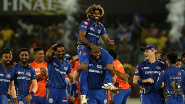 Kieron Pollard lifts Lasith Malinga on his shoulders after victory