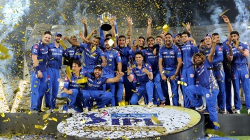 The Mumbai Indians players pose with the IPL 2019 trophy