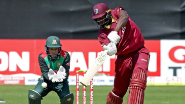 Jason Holder punches through the covers